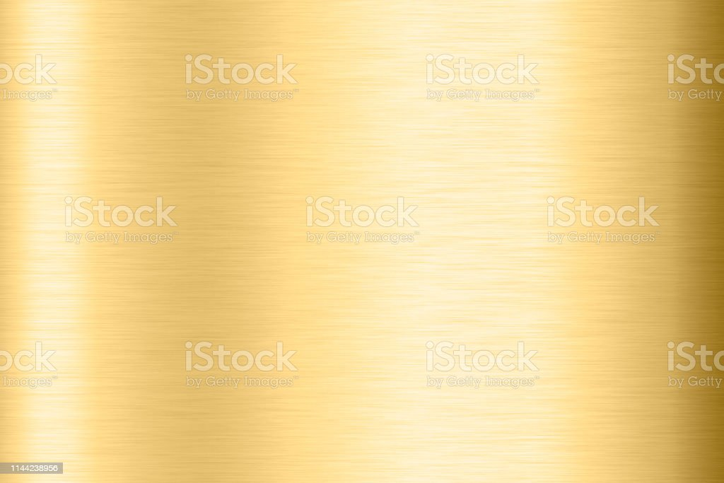 Abstract Shiny smooth foil metal Gold color background Bright vintage...