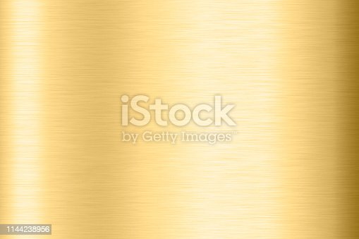 1053870408 istock photo Abstract Shiny smooth foil metal Gold color background Bright vintage Brass plate chrome element texture concept simple bronze leaf panel hard backdrop design, light polished steel banner wallpaper. 1144238956