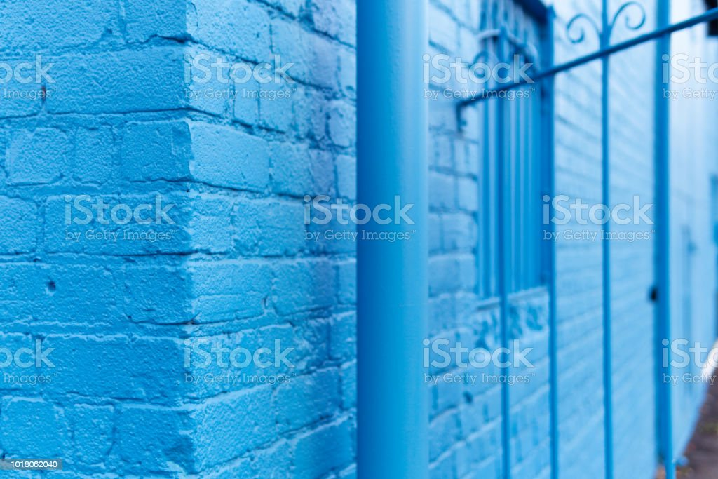 Abstract side-angled view from the corner of a blue brick building stock photo