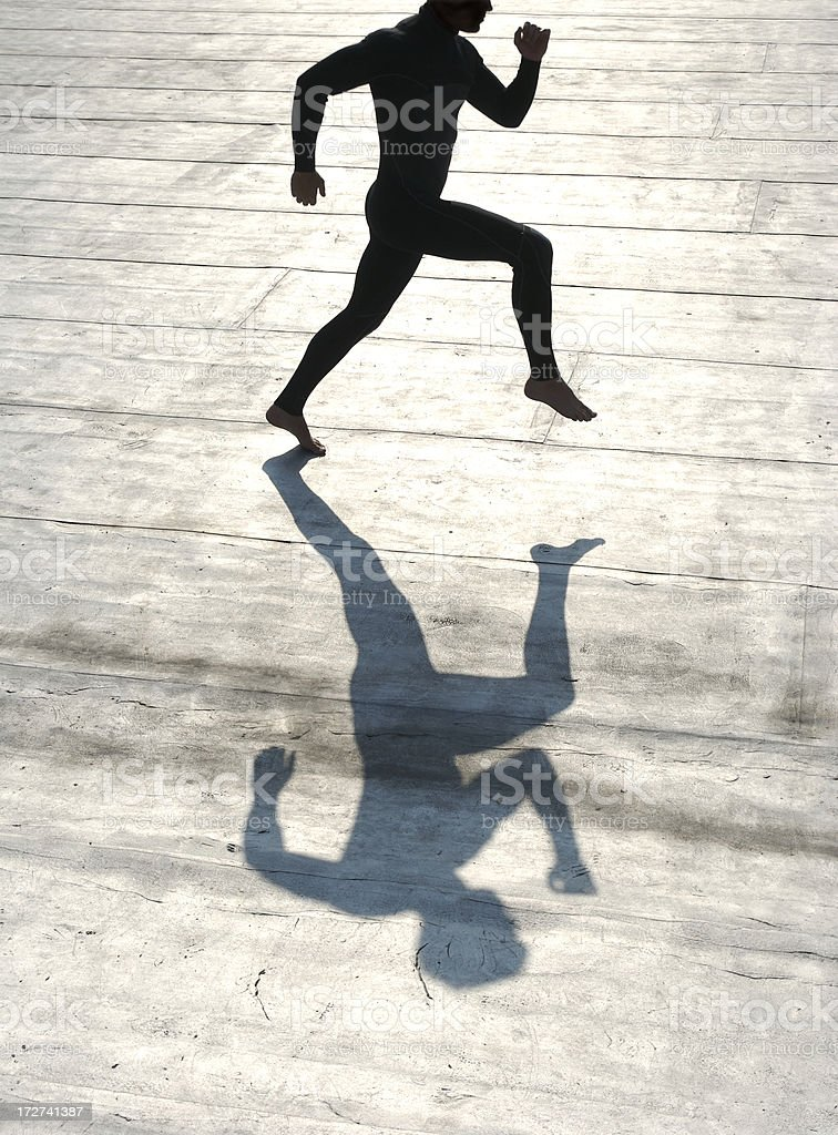 Abstract Silhouette of Athletic Man Running on Silver Background stock photo