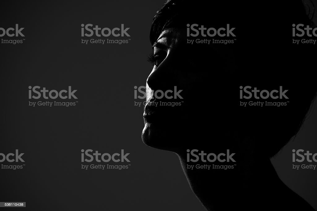 Abstract silhouette portrait of short hair woman looking at camera stock photo