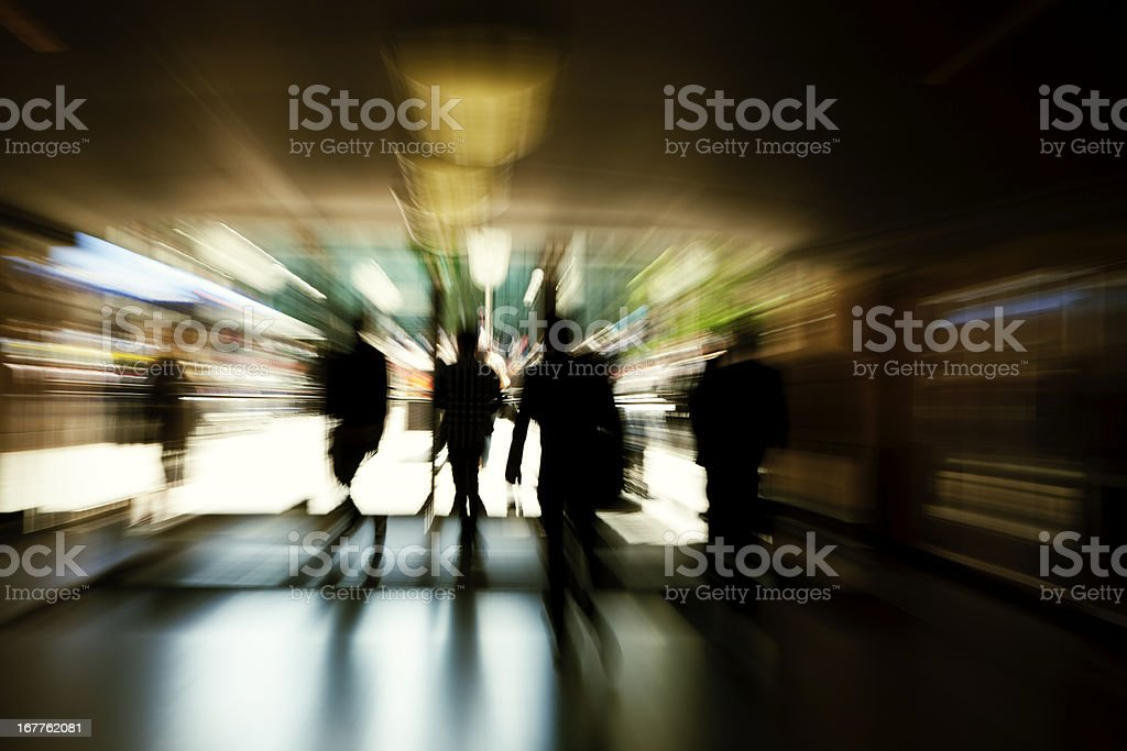 Abstract Silhouettes of Business Commuters Rushing Through Corridor royalty-free stock photo