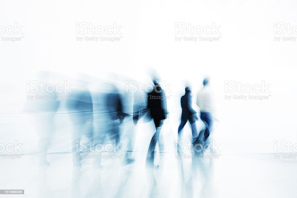 Abstract Silhouettes of Business People Walking Against White Background stock photo