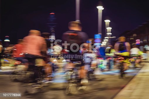 929609038istockphoto Abstract silhouettes of group colorful cyclists on city streets, abstract, motion blur, bike festival. Concept of healthy lifestyle, motion background 1017776344
