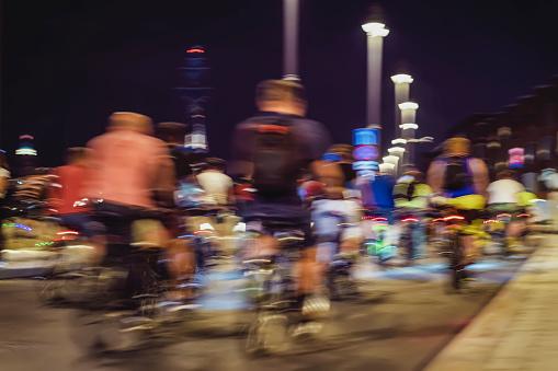 929609038 istock photo Abstract silhouettes of group colorful cyclists on city streets, abstract, motion blur, bike festival. Concept of healthy lifestyle, motion background 1017776344