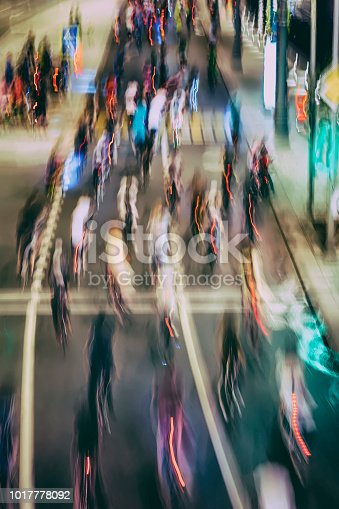 istock Abstract silhouettes of group colorful cyclists on city streets, abstract, motion blur, bike festival. Concept of healthy lifestyle, for background 1017778092