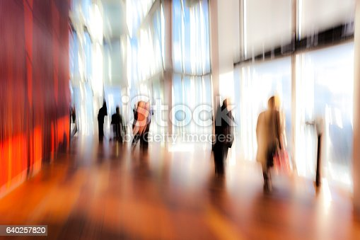 istock Abstract Silhouettes of Standing People in Modern Interior 640257820