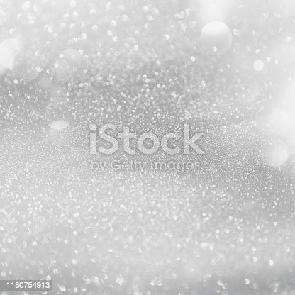866754590istockphoto Abstract silver glitter sparkle winter Christmas background. 1180754913