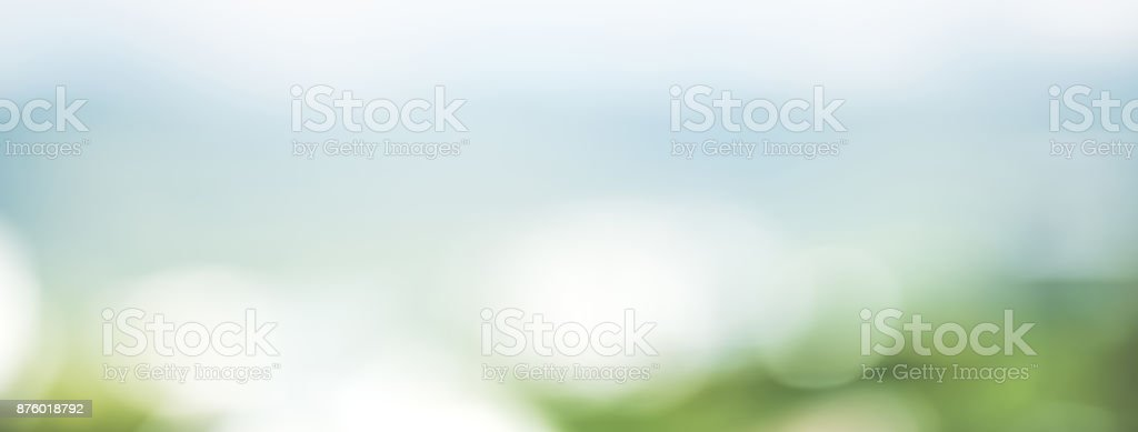 Abstract simple clean natural blur white green bokeh background with light blue shade in the middle stock photo
