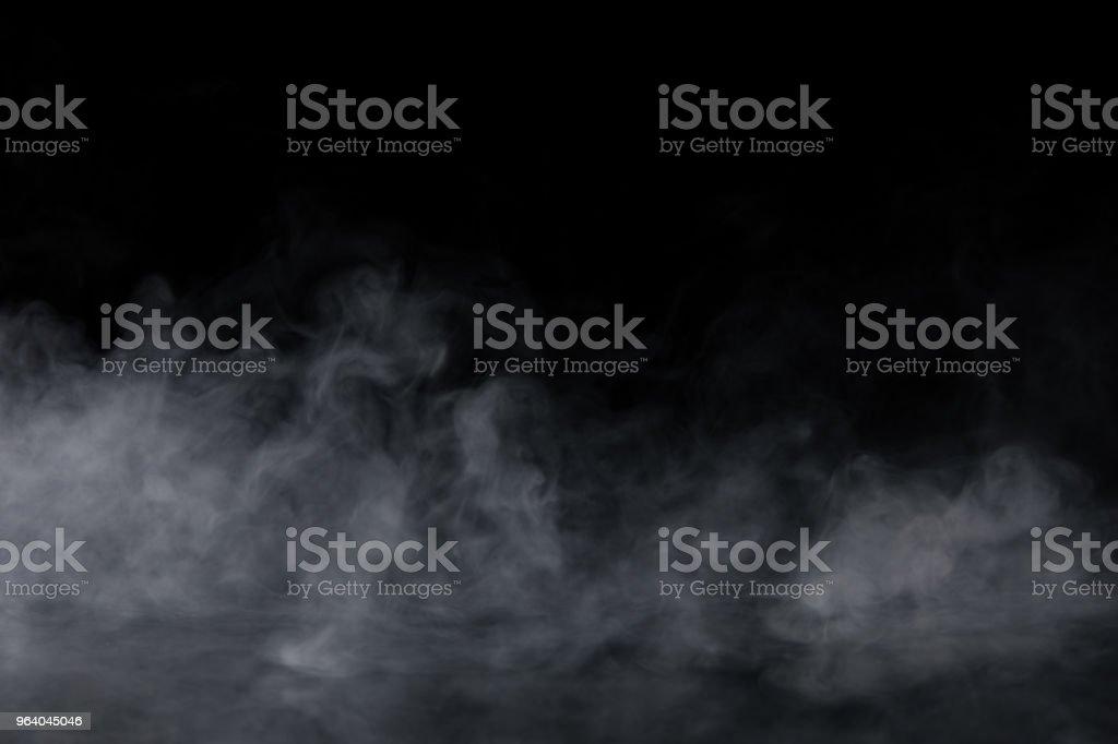 Abstraite fumée sur fond noir - Photo