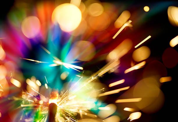 abstrakte wunderkerze hintergrund - weihnachtsideen stock-fotos und bilder