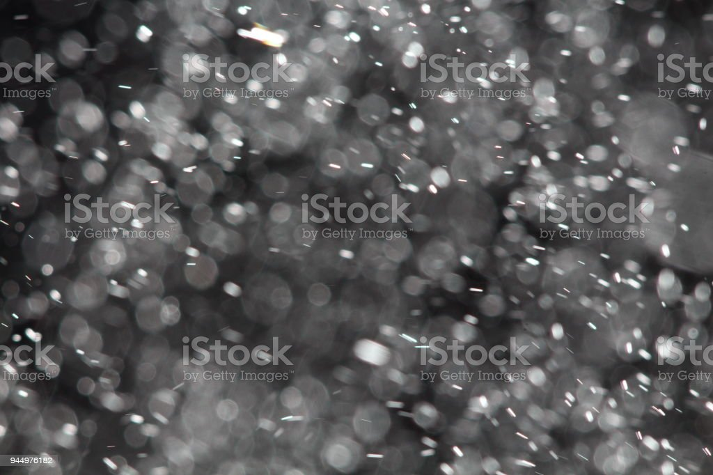 Abstract sparkles particle moving small large defocus different crystal plan overlay stock photo