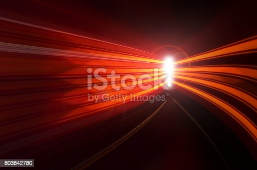 istock Abstract speed motion in highway road tunnel, blurred motion toward the central 803842780