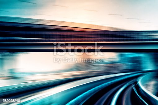 abstract motion-blurred view from the front of a train speeding through a city
