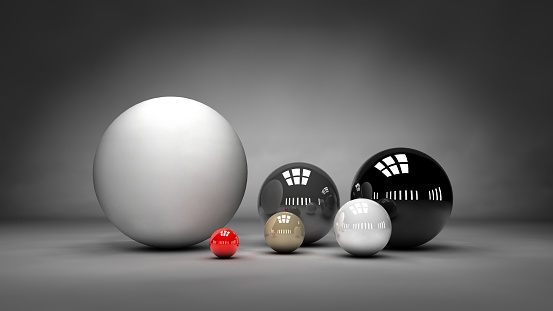 Spheres of different sizes, colors and textures artistically arranged on a gray background.