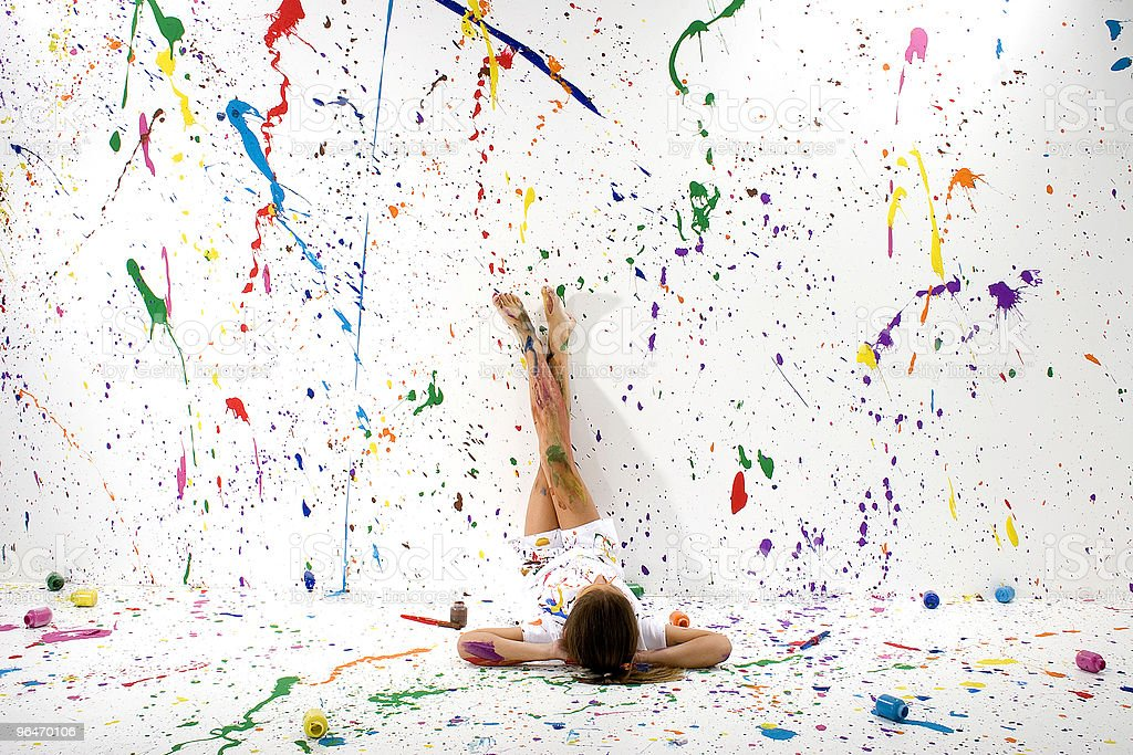 Abstract splatter art across a woman laying in a white room royalty-free stock photo