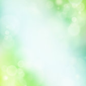 Abstract spring background with blue,cyan and green bubbles and color transitions. Lots of copy space,fine grain added.