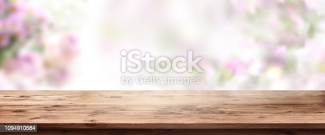 1135260918 istock photo Abstract spring scenery with wooden table 1094910584