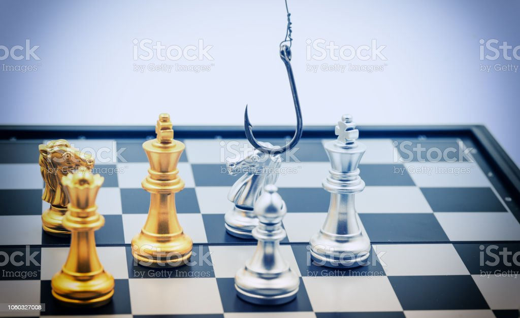 abstract steel hook on chess game for pishing trap blue vintage filter - can use to display or montage on product stock photo