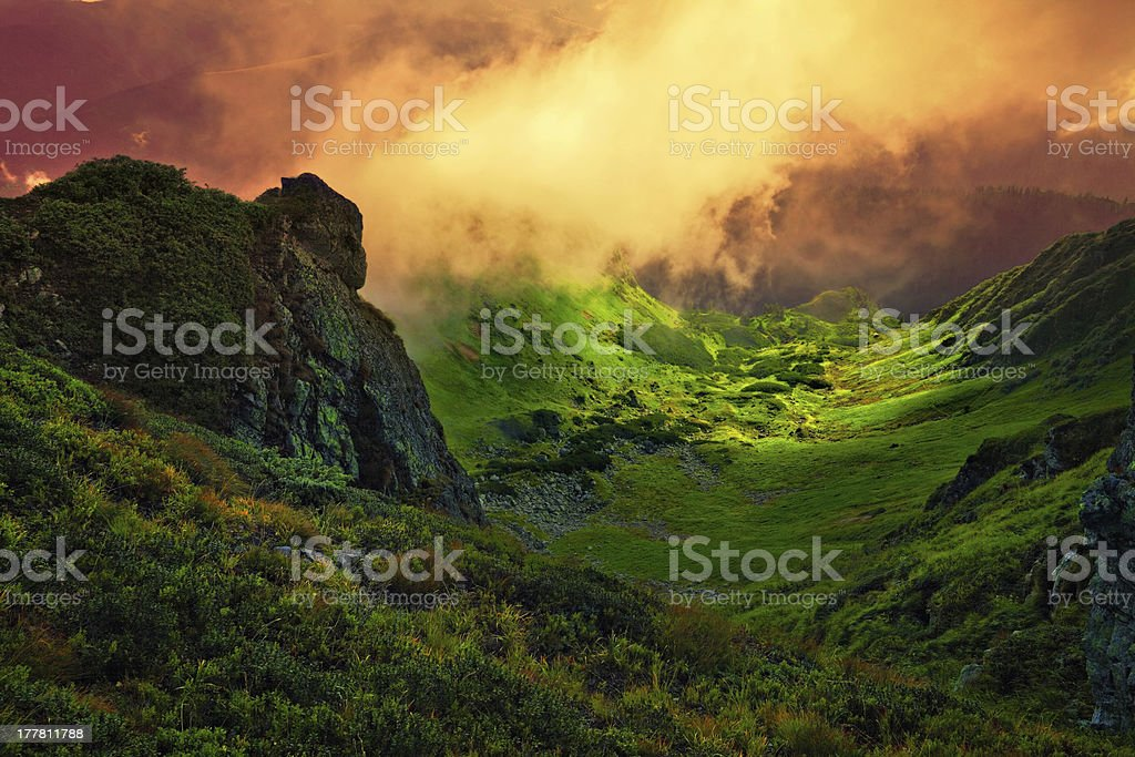 abstract stone giant and fog over mountain valley stock photo