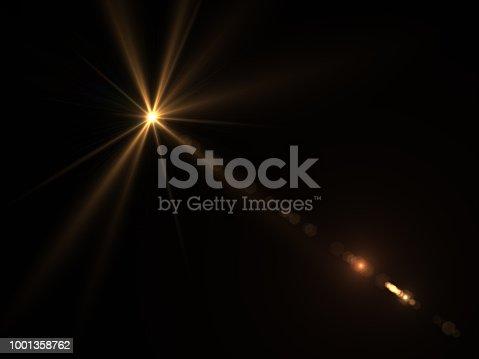 868064724istockphoto Abstract sun burst with digital lens flare light over black background 1001358762