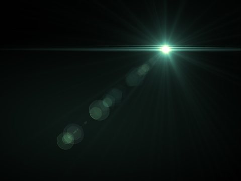 868064724 istock photo Abstract sun burst with digital lens flare light over black background 1001358764