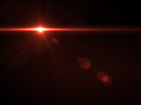 868064724 istock photo Abstract sun burst with digital lens flare light over black background 1001358766