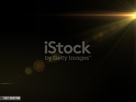 868064724istockphoto Abstract sun burst with digital lens flare light over black background 1001358768
