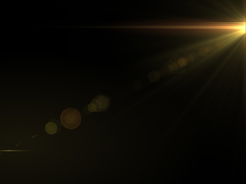 868064724 istock photo Abstract sun burst with digital lens flare light over black background 1001358768