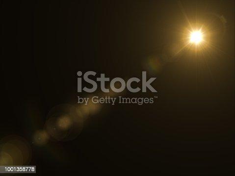 868064724istockphoto Abstract sun burst with digital lens flare light over black background 1001358778