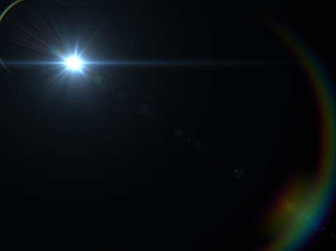 868064724 istock photo Abstract sun burst with digital lens flare light over black background 1001358784