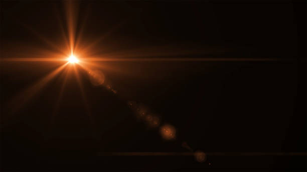 abstract sun burst with digital lens flare light over black background - luce solare foto e immagini stock