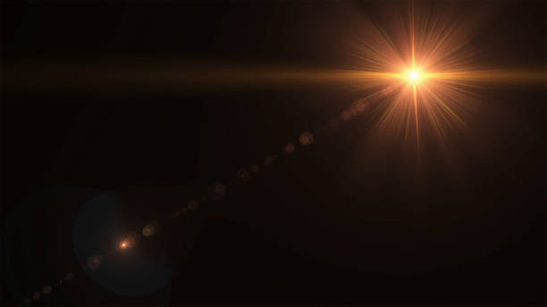 abstract sun burst with digital lens flare on the black background - riflesso foto e immagini stock