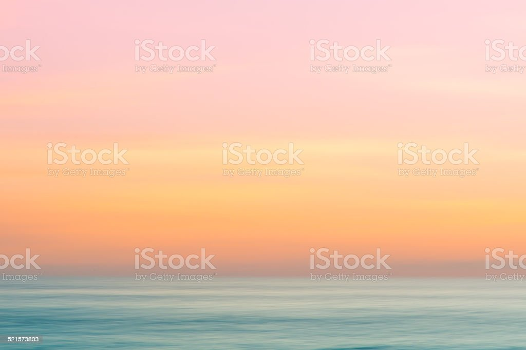 Abstract subset sky and ocean nature background with blurred panning...