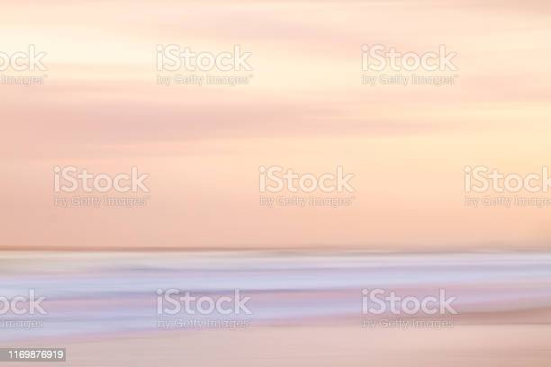 Photo of Abstract sunset sky and ocean background with blurred motion