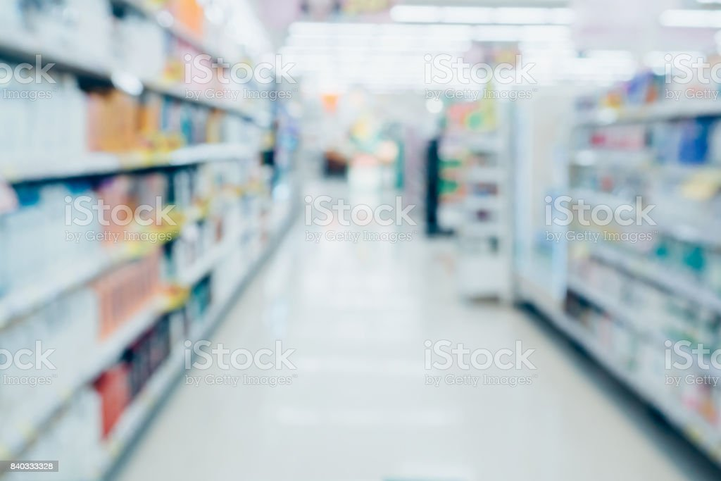 Abstract supermarket aisle with health and beauty product shelves blurred background stock photo