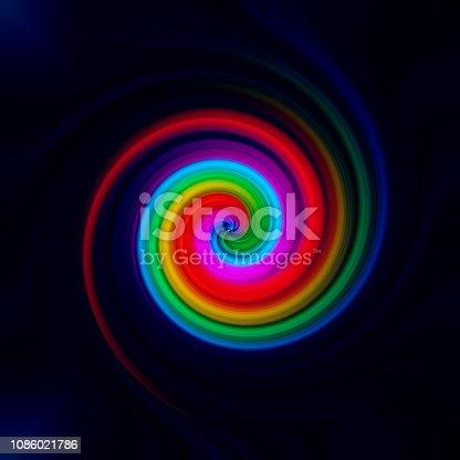 1061380420 istock photo Abstract swirl rainbow background 1086021786