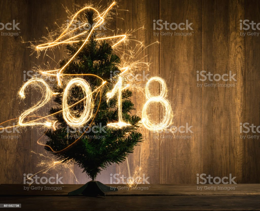abstract Symbolic Christmas tree with 2018 created using sparklers happy new year 2018 concept. stock photo