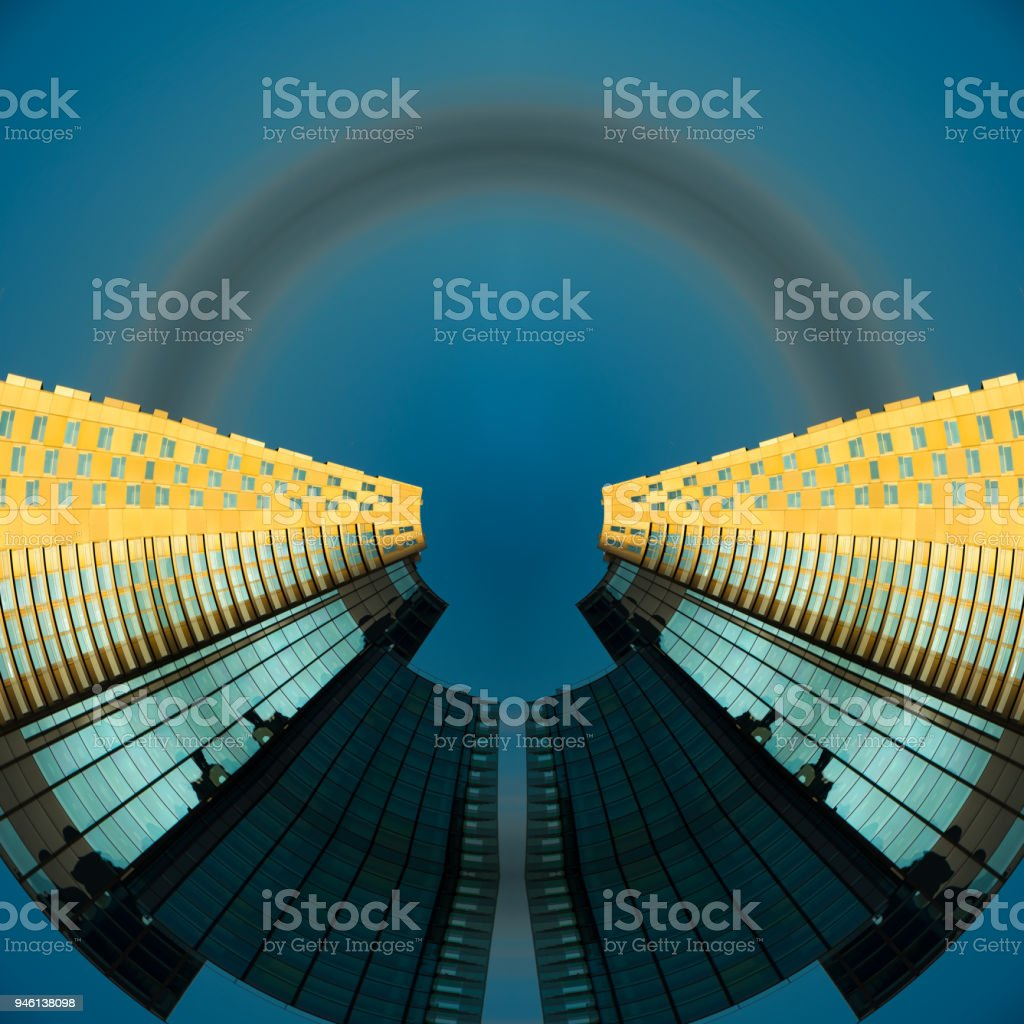 Abstract tall building reflecting sunset, mid air stock photo