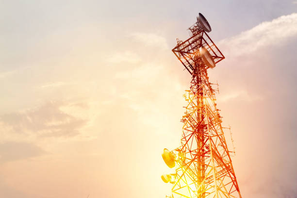 Abstract telecommunication tower Antenna and satellite dish at sunset sky background Abstract telecommunication tower Antenna and satellite dish at sunset sky background telecommunications equipment stock pictures, royalty-free photos & images