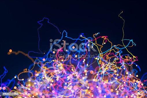 istock Abstract tendril particles 898633556