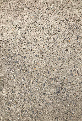 Abstract texture background a close-up look of the grey Stone road in the day light