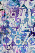 Abstract texture background with shades of blue, pink, and purple with white numbers and symbols painted on.