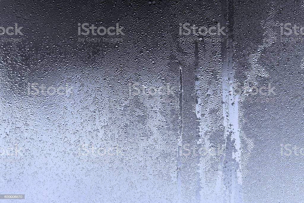 abstract texture of wet glass blue color stock photo