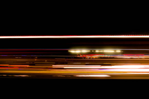 abstract traffic trail light on the road blurred - long exposure stock pictures, royalty-free photos & images