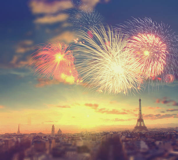 Abstract travel background: fireworks over Eiffel tower in Paris, France stock photo