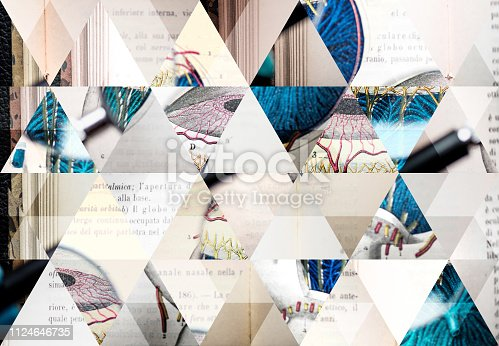 Abstract triangle mosaic background: Magnifying glass on antique anatomy book