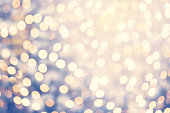 Abstract twinkled bright background with natural bokeh defocused lights.  Glitter vintage lights wallpaper.