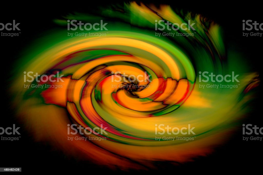 Abstract twirl of color in black stock photo