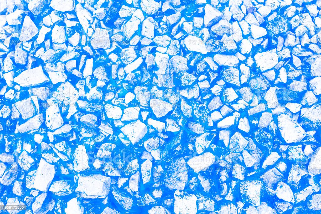 Abstract unrealistic background of stones and rocks on blue. Copy space. Template. stock photo
